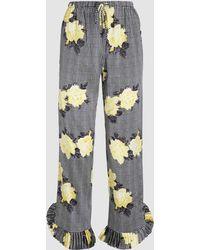 Ganni - Calla Silk Printed Ruffle Hem Trousers - Lyst