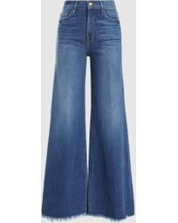 FRAME - Le Palazzo Frayed Flared Jeans - Lyst