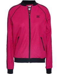 5619c2b33024 PUMA Ladies Evening Blue Exposed Zip Block Piqué Track Jacket in ...