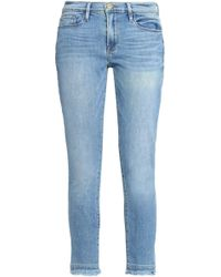FRAME - Frayed Faded Low-rise Skinny Jeans - Lyst