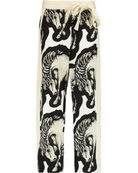 Issa - Printed Crepe Tapered Pants - Lyst