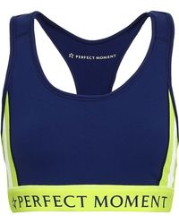 Perfect Moment - Woman Stripes Stars Neon-trimmed Printed Stretch Sports Bra Navy - Lyst