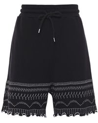McQ Ruffle-trimmed Embroidered French Cotton-terry Shorts Black