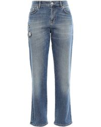 Versus Appliquéd Faded High-rise Slim-leg Jeans Mid Denim - Blue