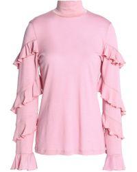 Nicholas - Ruffled Wool Turtleneck Top Baby Pink - Lyst