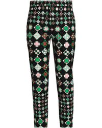 Emilio Pucci - Printed Cotton-blend Tapered Trousers - Lyst