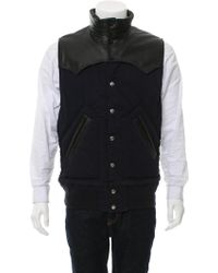 Sacai - Leather-accented Puffer Vest Navy - Lyst