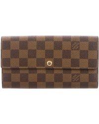 Louis Vuitton - Damier Ebene Sarah Wallet Brown - Lyst