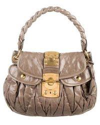 Pleats Please Issey Miyake. Pleated Shopper Tote.  330. Farfetch · Miu Miu  - Miu Matelassé Pleated Coffer Bag Gold - Lyst 4cd98de362