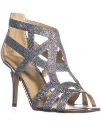 7fbdf5033d5a Lyst - Marc Fisher Nala3 Mid Heel Evening Sandals in Metallic