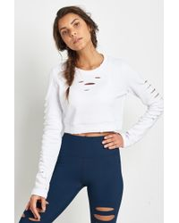 Alo Yoga | Ripped Warrior Long Sleeve White | Lyst