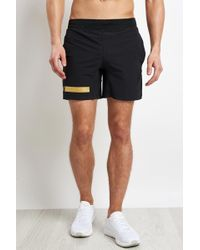 """Under Armour - Perpetual Short 9"""" Black/gold - Lyst"""
