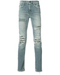 Saint Laurent Studded Distressed Jeans - Blue