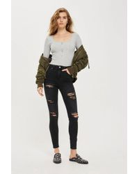 TOPSHOP - Moto Washed Black Super Ripped Jamie Jeans - Lyst