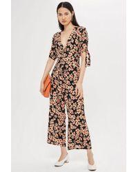 TOPSHOP - Daisy Print Wrap Jumpsuit - Lyst