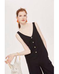 TOPSHOP - Button Slouch Jumpsuit - Lyst