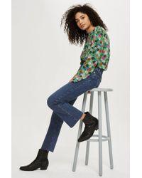 TOPSHOP - Tall Indigo Dree Cropped Kick Jeans - Lyst