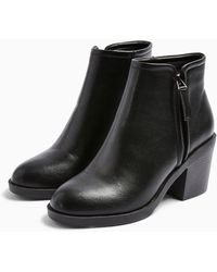 d30db02de68 Dior Unit Preforated Calfskin Leather Ankle Boot in Black - Lyst