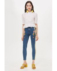 TOPSHOP - Moto Mid Blue Embroidered Side Stripe Jamie Jeans - Lyst