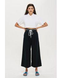 TOPSHOP - Wash Black Pleated Crop Jeans - Lyst