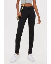 TOPSHOP - Petite Black Leigh Skinny Jeans - Lyst