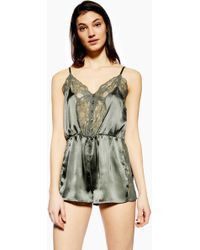 d47b5ded5d Lyst - TOPSHOP Knot Front Plunge Playsuit in Pink