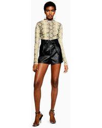 TOPSHOP - Petite Leather Look Zip Shorts - Lyst