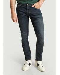 Carhartt Dunkelblaue Rebel Slim Fit Jeans in abgenutzter Waschung - Mehrfarbig