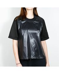 Nike T-shirt tissé noir / noir Femme