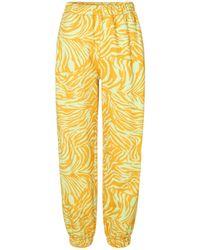 Stine Goya Zaza Trackpant en Zebra Orange - Amarillo