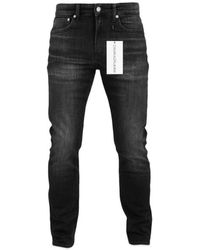 Calvin Klein Ckj 058 Slim Tapered Jeans Lille Black Washed Grey