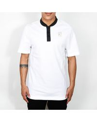 Nike - Polo bianca nera e metallizzata - Lyst