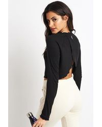 Free People Top nero a coste e cuciture nere