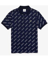 Lacoste Https://www.trouva.com/it/products/-navy-slim-fit-logo-printed-polo-shirt - Blu