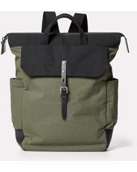 Ally Capellino Fin Waxed Cotton Rucksack In Black And Olive