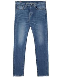 Edwin Https://www.trouva.com/it/products/-slim-tapered-jeans-made-in-japan-blue-mid-used-l32