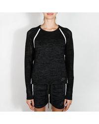 Nike Haut ras du cou en tricot noir Tech