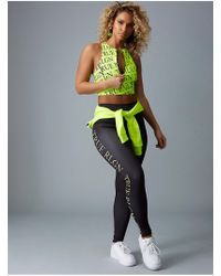True Religion - Bodied Neon Yellow Repeat Logo Legging - Lyst