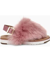 ad39e2489c01 Lyst - UGG Ugg Holly Genuine Shearling Sandal in Orange