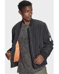 53e85df4b63e Lyst - Moncler  Freddie  Padded Biker Jacket in Black for Men