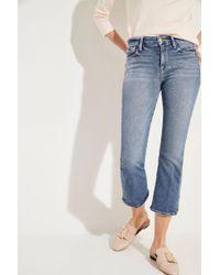 FRAME - Jeans 'Le Crop Mini Boot' mit Druckknöpfen Blau - Lyst