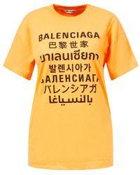 Balenciaga - Oversized T-Shirt mit schwarzem Logo-Print Orange - Lyst