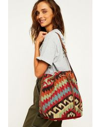 Urban Outfitters - Geo Tapestry Drawstring Bucket Bag - Lyst
