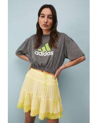 Urban Outfitters Uo Tie-dye Anna Mini Prairie Skirt - Yellow