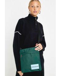 Calvin Klein - Sport Essential Teal Flat Pack Crossbody - Lyst