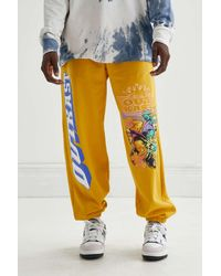 Urban Outfitters Outkast Graphic Sweatpant - Yellow