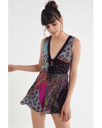 e25907143b8c Urban Outfitters Uo Poppy Sweetheart Fit + Flare Romper in Purple - Lyst