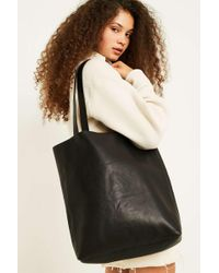 f360459982fb Urban Outfitters Reversible Vegan Leather Oversized Tote Bag in ...