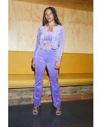 Juicy Couture UO Exclusive - Ausgestellte Trainingshose in dunklem Flieder - Blau