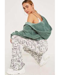 Urban Renewal Vintage Remnants Dollar Flare Trousers - White